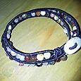 Bracciale elastico con perle di Agata naturale. Chiusura in argento 999